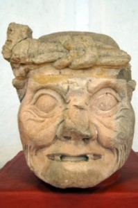 Stone head of old man - original in Copan museum, Honduras