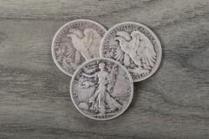 Old silver half dollars on aging wood background